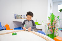 Child playing with trains.