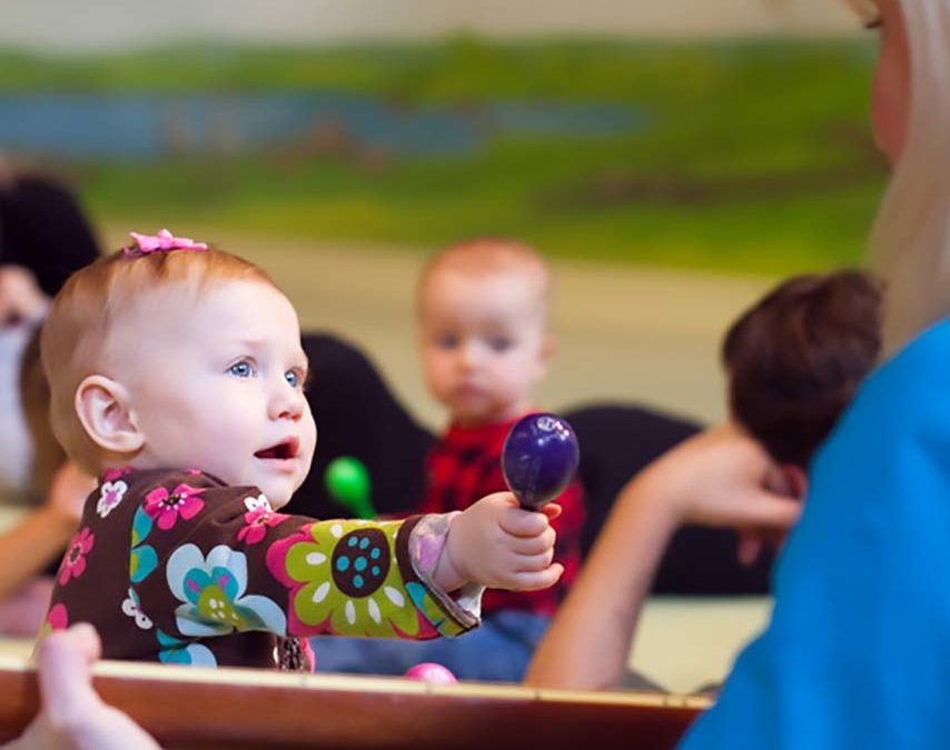 Baby girl in a music class for walkers.